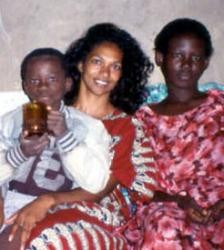 Parikh (center) and research subjects in Uganda. - IMAGE VIA