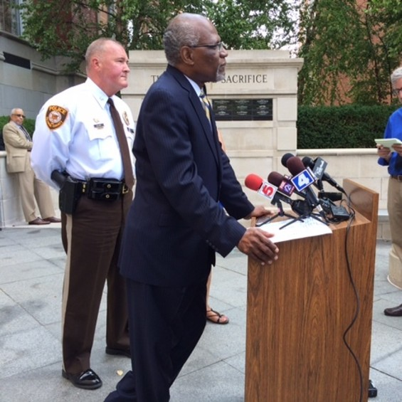 "County Executive Charlie Dooley, with police chief Jon Belmar behind him, tells media he is disappointed in the lootings Sunday night in Ferguson. ""I understand the community's frustration and desire for information."" - LINDSAY TOLER"