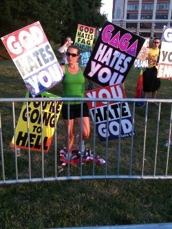 Megan Phelps, grand-daughter of Fred, protesting outside a St. Louis concert last week.