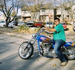 Rep. Caleb Jones on a motorcycle. - TWITTER/CALEB JONES