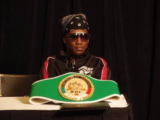 Dannie Williams, here with his WBC Continental Americas lightweight title, hopes to add another mid-level belt to his resume on March 30. - ALBERT SAMAHA