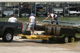 Bad news! Agents remove a guy's boatlift that had an invasive species attached to it. - COURTESY MISSOURI DEPARTMENT OF CONSERVATION