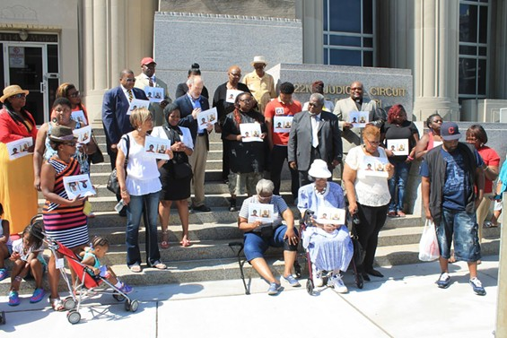 Family and supporters of Anthony Williams pray outside the Circuit Court building. - RAY DOWNS