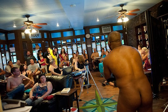 """A nude David Wraith (he of the butt) gives his presentation at a """"body positive event"""" at Shameless Grounds in July 2013 - JON GITCHOFF"""