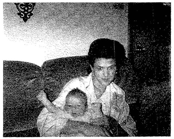 Angel Stewart and a relative's baby in an undated photo.