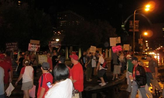 OccupySTL protesters greet Cardinals fans last night near Kiener Plaza. - PHOTOS: CHAD GARRISON