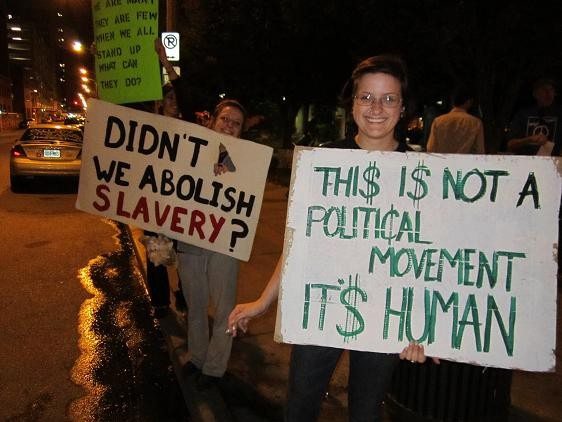 OccupySTL says it's movement has grown each day. These women came out for their first time last night.