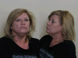 Janice Lyles of Godfrey was arrested after passing out drunk in the Hardee's drive-thru