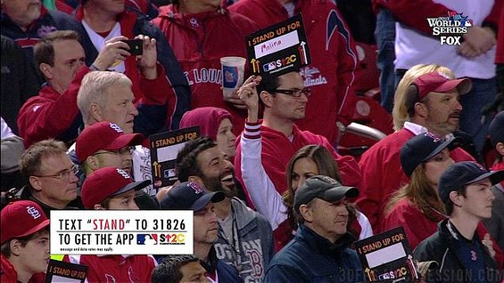 Sarah Newlon and her Red Sox fan friend laugh during a somber moment honoring cancer survivors at Busch Stadium during World Series Game Four.