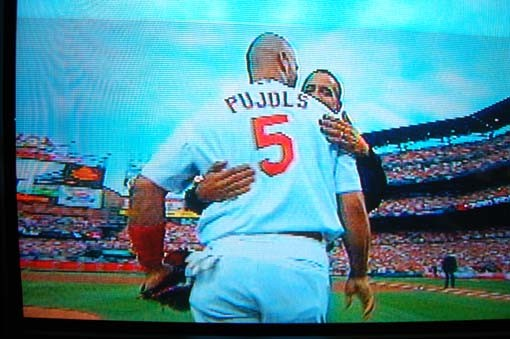 Obama hugs Pujols after what's generally considered to be decent, as first pitches go, toss to home plate.