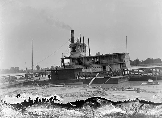 "A hard working riverboat named ""Dr. Frederick Hill"" takes on cargo. Below the image is some deterioration of the emulsion, looking at first glance like waves. - COURTESY OF JOHN FOSTER"