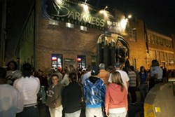 Thrill seekers gather outside The Darkness in October 2008.