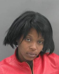 Tizzy Dickerson aimed for the head, according to prosecutors.