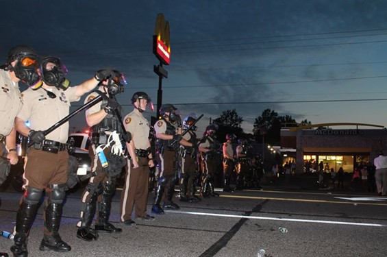 Police in riot gear at the beginning of protest. - RAY DOWNS