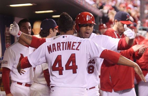 Taveras hugs it out with teammate Carlos Martinez. - UPI/BILL GREENBLATT