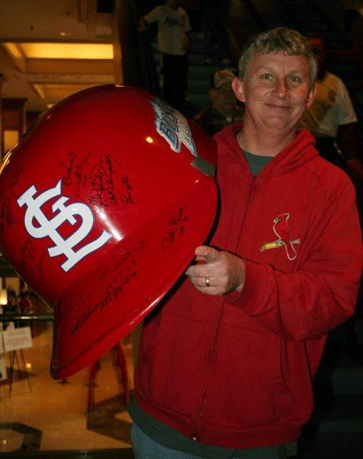 Kevin Meyer displays a helmet large enough to fit the swollen head of even the most egotistical Cardinal, save for that arrogant bastard Fredbird. - PHOTO: EMILY GOOD