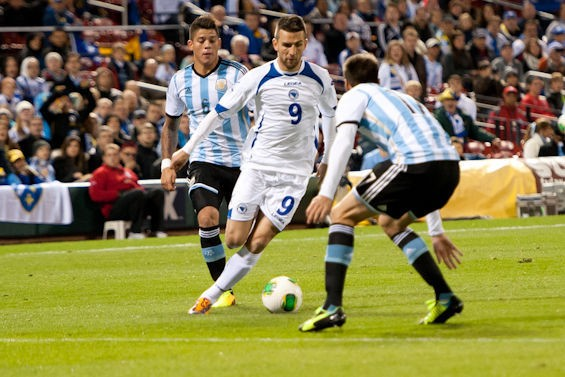Vedad Ibisevic against Argentina's defense at Busch Stadium. - JON GITCHOFF