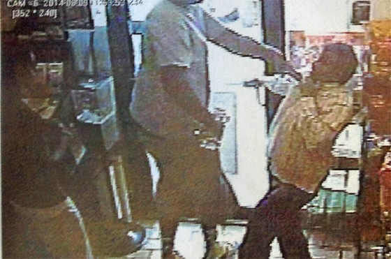 Ferguson police say this image shows Michael Brown roughing up a convenience-store owner just prior to an officer shooting the suspect.