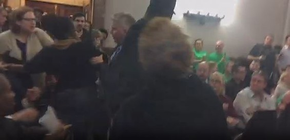 Jeff Roorda, police union business manager, grabs Cachet Currie's arm as the scuffle begins. - VIA USTREAM