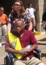 Gladney in a wheelchair two days after the alleged assault.