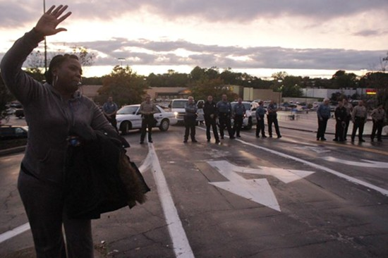 A woman protests in front of the Ferguson Walmart yesterday, one of a string of locations protesters targeted. - DANNY WICENTOWSKI
