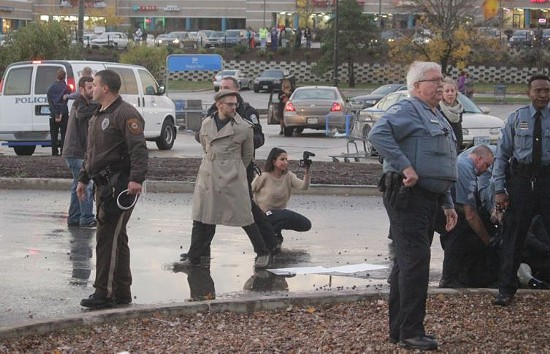 Another protester arrested at the Ferguson Walmart. - DANNY WICENTOWSKI