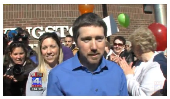 Woodworth greeting his family after his release in February. - VIA FOX4KC.COM