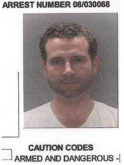 Ohlsen's mug shot as it appears in an arrest report from March 2008 when police in Ladue found him in possession of a stolen .40 caliber Glock handgun.