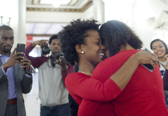 Ferrell and Templeton embrace after Ferrell says yes to her marriage proposal at St. Louis City Hall on December 16. Deray McKesson, another Ferguson activist, captures the moment for Twitter.