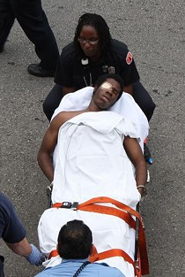 Williams, handcuffed to a stretcher - PHOTO BY NICHOLAS PHILLIPS