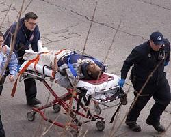 Sean Johnson being wheeled away from the scene by paramedics. - JOSH ROWAN