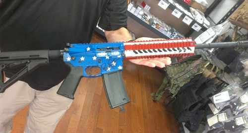 The AR-15 is autographed by MMA fighter Randy Couture, who runs a charity for veterans. - RAY DOWNS