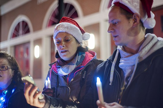 Jessica Crotzer and Colt Pisciotta sing in front of the Ferguson Fire Station on South Florissant Road.