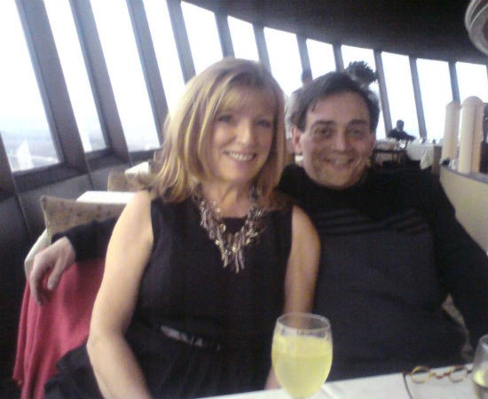 Trudi Alexander and her husband at the Millenium Hotel revolving restaurant on Christmas. - COURTESY OF ALEXNADER.