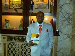 Dwayne L. Buckingham shows off his new book Qualified, Yet Single and his excellent fashion sense in the lobby of the Tivoli Theatre.