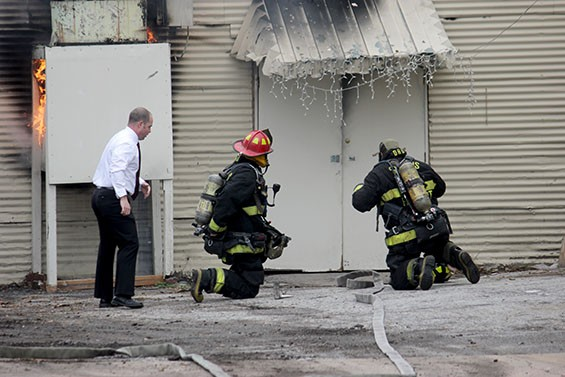 Firefighters such as Aaron Buchanan, in the white shirt, are never really off duty. - PHOTOS BY DANNY WICENTOWSKI