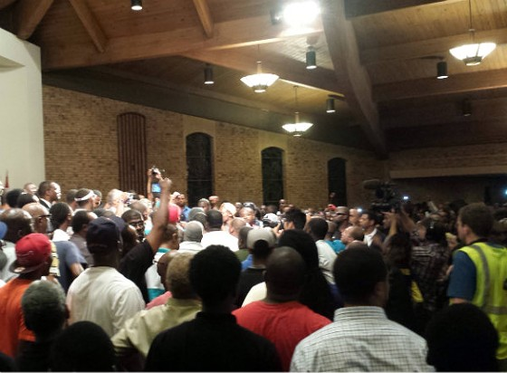 Rev. Al Sharpton surrounded by young men on stage at Greater St. Mark's Missionary. - JESSICA LUSSENHOP