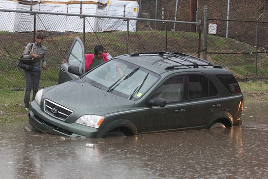 Three cars were stranded after heavy rains Wednesday. No injuries were reported. - UPI/BILL GREENBLATT