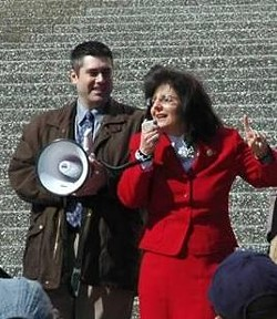 Davis speaking at a gun rally earlier this month on the St. Louis riverfront. - CYNTHIADAVIS.NET