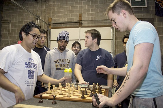 """Jake Banawa faces Vitaly Neimer in the first chess match of the day."""