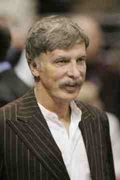 Stan Kroenke looks toward London, presumably.