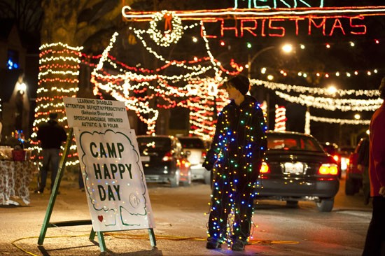 missey doll of st louis functions as traffic control director and decoration on candy cane - Christmas Lights St Louis