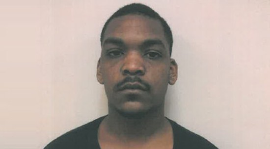 Marlon Miller's mug shot after he was wrongfully charged.