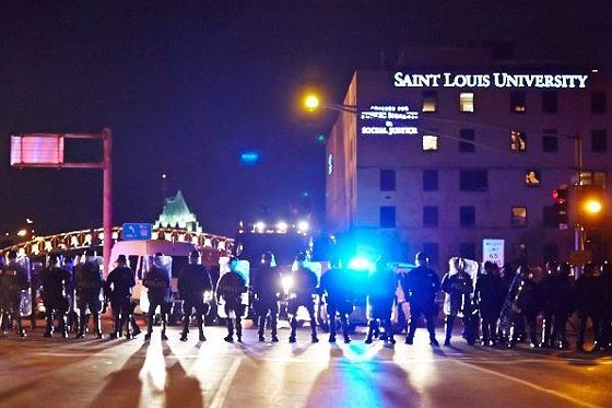 St. Louis police in riot gear block South Grand Boulevard shortly after protesters shut down Interstate 44. See more photos here. - THEO WELLING