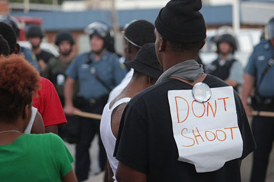 Protesters face police in riot gear in the days after Michael Brown's death. - DANNY WICENTOWSKI