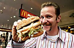 Is that a handlebar 'stache or one half of the McDonald's golden arches?