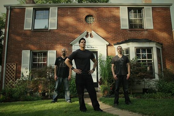 "Ghost Adventures stars Aaron Goodwin, Zak Bagans and Nick Groff outside the St. Louis ""Exorcist House."" - TRAVEL CHANNEL"