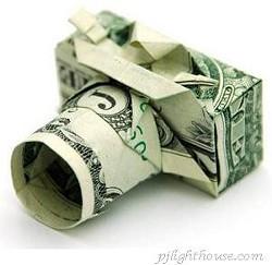City: Cameras increase safety. Critics: Cameras increase cash.
