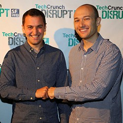 Lyft co-founders John Zimmer (L) and Logan Green fist bump. - TECH CRUNCH ON FLICKR, CROPPED