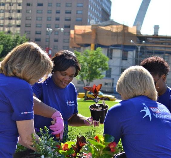 Volunteers for Gateway Greening under the arch. - COURTESY GATEWAY GREENING